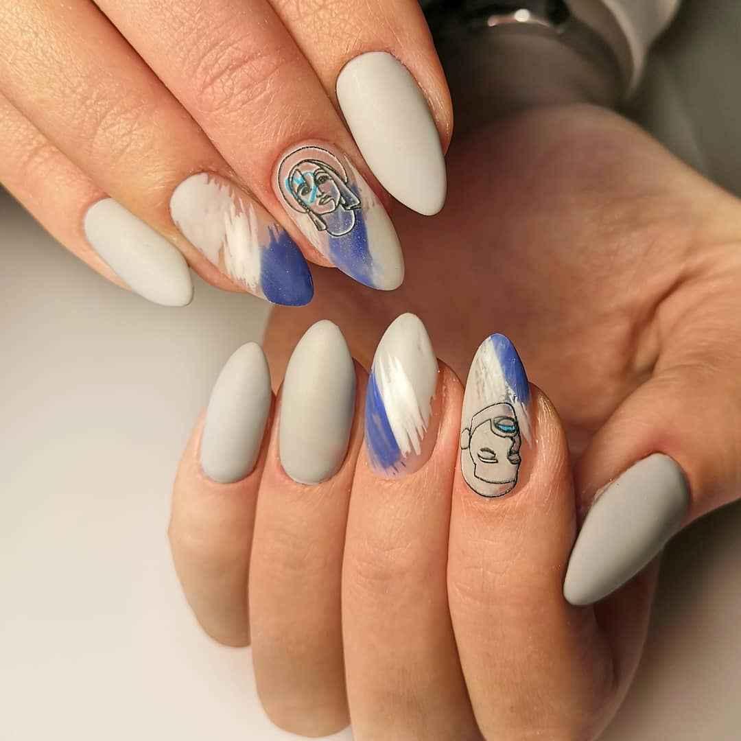 Маникюр с лицами на ногтях фото_15
