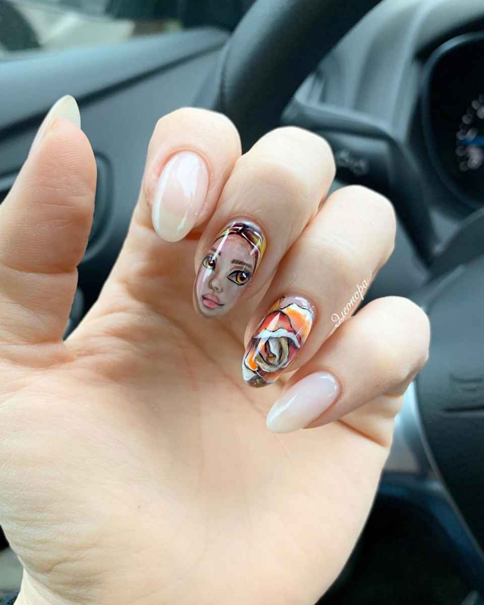 Маникюр с лицами на ногтях фото_46