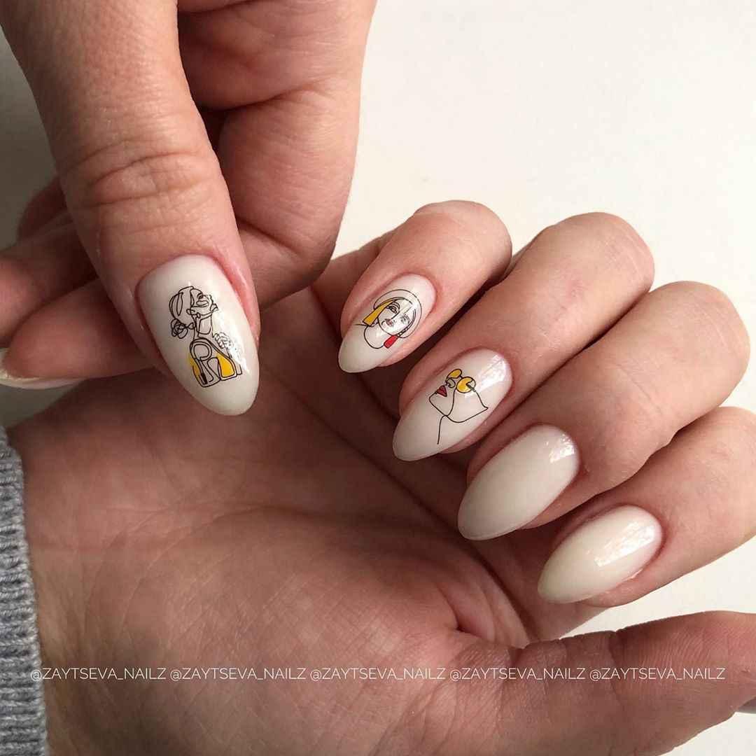 Маникюр с лицами на ногтях фото_39